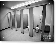 cubicle toilet stalls in womens bathroom in a High school canada north america Acrylic Print