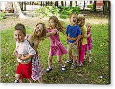 Cute Children Playing At Park Acrylic Print by UygarGeographic