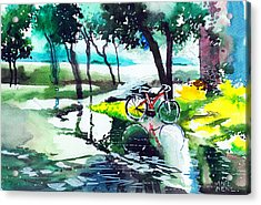 Cycle In The Puddle Acrylic Print by Anil Nene