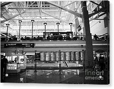 departures board at concourse b Denver International Airport Colorado USA Acrylic Print by Joe Fox