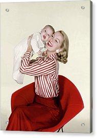 Dina Merrill Holding A Baby Acrylic Print