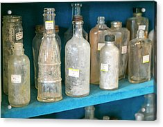 Dirty Antique Glass Bottles On Display Acrylic Print