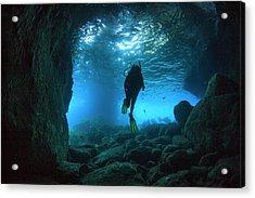 Diver Swimming Through A Sea Cave Acrylic Print