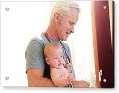 Doctor Holding Baby Acrylic Print