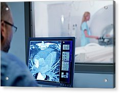 Doctor Looking At Mri Scan On Monitor Acrylic Print by Science Photo Library