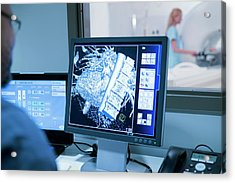 Doctor Looking At Mri Scans On Monitor Acrylic Print by Science Photo Library