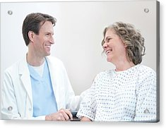 Doctor Smiling At Woman Patient Acrylic Print by Science Photo Library