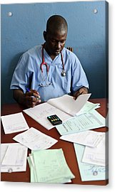 Doctor With Patient Notes Acrylic Print by Matthew Oldfield