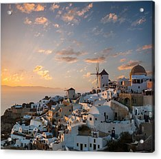 Dramatic Sunset Over The Windmills Of Oia Village In Santorini Acrylic Print