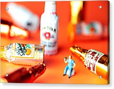 Drinking Among Liquor Filled Chocolate Bottles Acrylic Print by Paul Ge