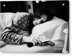 Early Twenties Woman With Hand On Handgun Under Pillow At Night In Bed In A Bedroom Acrylic Print by Joe Fox
