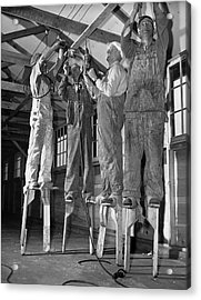 Electricians On Stilts Acrylic Print by Underwood Archives