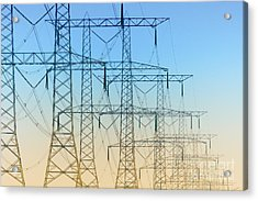 Electricity Pylons Standing In A Row Acrylic Print by Nick  Biemans