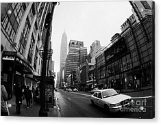 Empire State Building Shrouded In Mist As Yellow Cab Taxi New York City Acrylic Print by Joe Fox