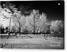 empty childrens playground with hoar frost covered trees on street in small rural village of Forget  Acrylic Print by Joe Fox