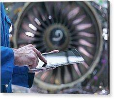 Engineer Using Digital Tablet In Front Acrylic Print by Monty Rakusen