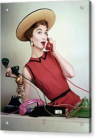 Evelyn Tripp Holding Telephones Acrylic Print by Erwin Blumenfeld