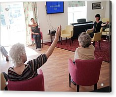Exercise Class At A Care Home Acrylic Print by John Cole