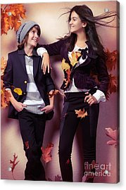 Fashionably Dressed Boy And Teenage Girl Under Falling Autumn Le Acrylic Print by Oleksiy Maksymenko