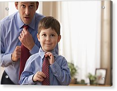 Father And Son Fixing Ties Together Acrylic Print by SelectStock