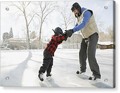 Father Teaching Son To Ice-skate On Outdoor Rink Acrylic Print by Hero Images