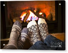Feet Warming By Fireplace Acrylic Print by Elena Elisseeva