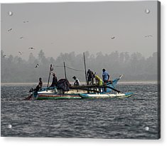 Fisherman Hauling Nets Aboard In Waters Acrylic Print by Panoramic Images
