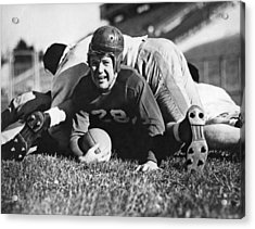 Football Player Gets Tackled Acrylic Print by Underwood Archives