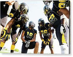 Football Team Huddled During Time Out Acrylic Print by Asiseeit