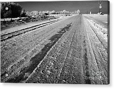 frozen salt and grit covered rural small road in Forget Saskatchewan Canada Acrylic Print
