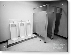 full length urinals and cubicles in mens toilet of High school canada north america Acrylic Print by Joe Fox