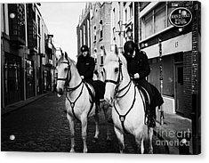 Garda Siochana Mounted Police On Horseback Taking Notes In Temple Bar Dublin Republic Of Ireland Acrylic Print by Joe Fox