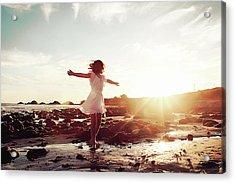 Girl Dancing On Beach At Sunset Sun Rays Acrylic Print