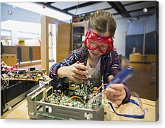 Girl Goggles Assembling Electronics Circuit At Science Center Acrylic Print by Hero Images