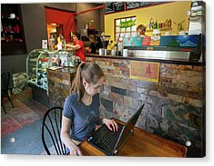 Girl Using A Laptop In A Cafe Acrylic Print by Jim West