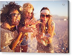 Girls Blowing Confetti From Their Hands On A Beach Acrylic Print by Wundervisuals