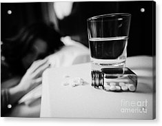 Glass Of Water And Bottles Of Sleeping Pills On Bedside Table Of Early Twenties Woman In Bed In A Be Acrylic Print by Joe Fox