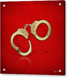 Gold Handcuffs On Red Leather Background Acrylic Print