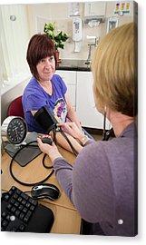 Gp Examining Patient Acrylic Print by Jim Varney