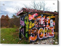 Graffiti Covered Building In Field Acrylic Print