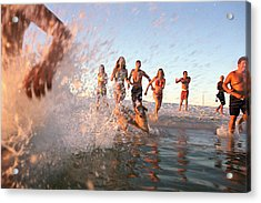 Group Of Young Adults Running Through Water At Ocean's Shore Acrylic Print by Sean Murphy