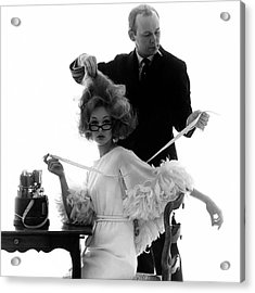 Hairstylist Kenneth Holding The Hair Of A Model Acrylic Print by Bert Stern