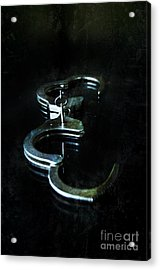 Handcuffs On Black Acrylic Print by Jill Battaglia