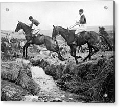 Horses Jumping A Creek Acrylic Print by Underwood Archives
