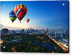 Hot Air Balloons Fly Over Cityscape At Sunset Background Acrylic Print by Busakorn Pongparnit