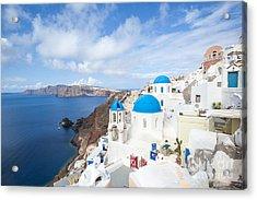 Iconic Blue Domed Churches In Oia Santorini Greece Acrylic Print