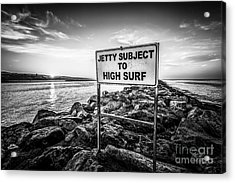 Jetty Subject To High Surf Sign Black And White Picture Acrylic Print by Paul Velgos