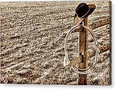 Lasso And Hat On Fence Post Acrylic Print by Olivier Le Queinec