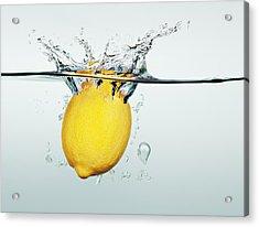 Lemon Splashing In Water Acrylic Print by Martin Barraud