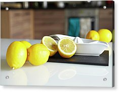 Lemons And Juicer On Kitchen Counter Acrylic Print by Debby Lewis-harrison